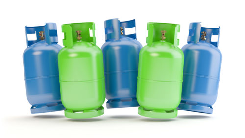 Blue and green gas bottles